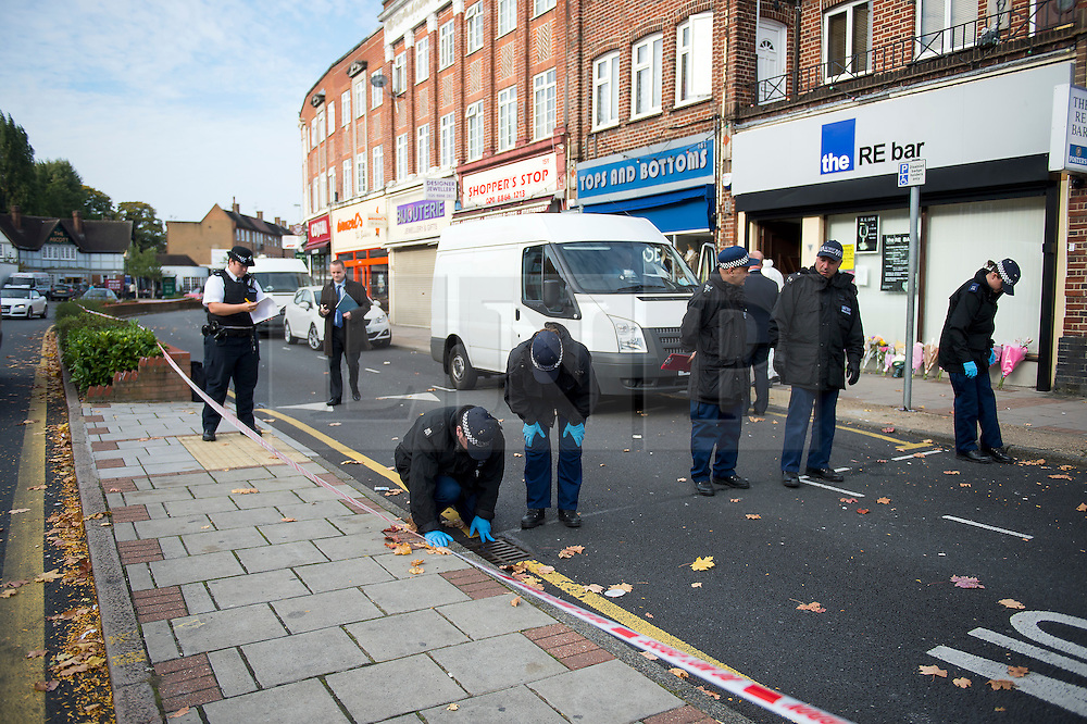 © Licensed to London News Pictures. 11/10/2015. London, UK. Police perform fingertip searches at The scene outside the RE bar in Field End Road, Eastcote, Hillingdon where a man was stabbed to death early this morning (SUN). The victim is believed to be  21-year-old Josh Hanson from Kingsbury.  Photo credit: Ben Cawthra/LNP