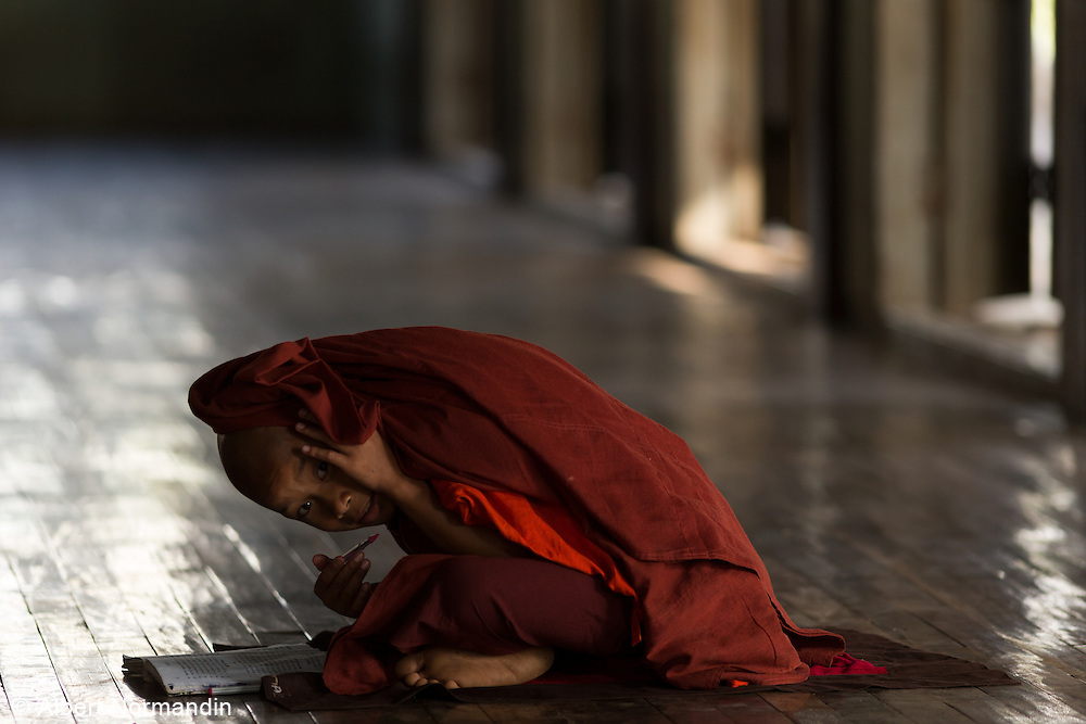 Novice Monk studying looks up from hiding, Aung Ban