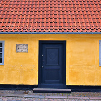 Hans Christian Andersen House in Odense, Denmark <br /> Fans of author H. C. Andersen will enjoy visiting two of his former residences in Odense. This modest yellow house is where he was born in 1805. It is easy to miss if you are not watching for it at the intersection of Hans Jensens Stræde and Bangs Boder. His childhood home, where he lived from the age of two until he became a teenager, is located a short distance away.