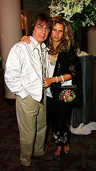 MR & MRS BILL WYMAN he is the former member of rock group The Rolling Stones, at an exhibition in London on 20th September 1999.MWN 20