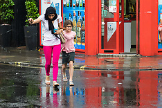 2017-06-02 London weather - people take cover from a downpour in Soho