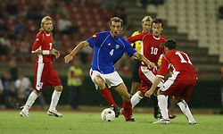BELGRADE, SERBIA & MONTENEGRO - Wednesday, August 20, 2003: Serbia & Montenegro's Dragan Mladenovic turns Wales' Simon Davies and Ryan Giggs during the UEFA European Championship qualifying match at the Red Star Stadium. (Pic by David Rawcliffe/Propaganda)