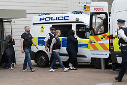 © Licensed to London News Pictures. 04/06/2017. LONDON, UK.  Two covered women (pictured) are removed by police officers outside the block of flats in Kings Road, Barking that police raided this today in connection with terror attack and four women were removed from the flats by police this lunchtime.  Photo credit: Vickie Flores/LNP