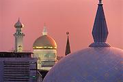 Sunset after a rainstorm - the Omar Ali Saifuddien Mosque.(left).Bandar Seri Begawan, Brunei..?Jeremy Horner