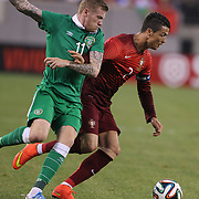 Cristiano Ronaldo, Portugal, is challenged by James McClean, Ireland, during the Portugal V Ireland International Friendly match in preparation for the 2014 FIFA World Cup in Brazil. MetLife Stadium, Rutherford, New Jersey, USA. 10th June 2014. Photo Tim Clayton