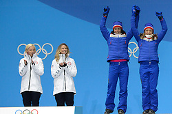 February 22, 2018 - Pyeongchang, South Korea - MARIT BJOERGEN and MAIKEN CASPERSEN FALLA of Norway celebrate getting the bronze medal in the Ladies' Team Srint Free cross-country skking event in the PyeongChang Olympic Games. (Credit Image: © Christopher Levy via ZUMA Wire)