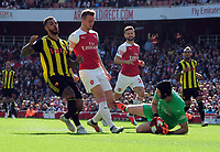 FOOTBALL - 2018 / 2019 Premier League - Arsenal vs. Watford<br /> <br /> Petr Cech of Arsenal wins the ball with Rob Holding, at the Emirates<br /> <br /> COLORSPORT/ANDREW COWIE