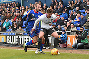 Bury Midfielder, Andrew Tutte sheperds the ball out of play during the Sky Bet League 1 match between Oldham Athletic and Bury at Boundary Park, Oldham, England on 23 January 2016. Photo by Mark Pollitt.