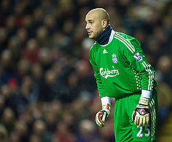 LIVERPOOL, ENGLAND - Saturday, December 26, 2009: Liverpool's goalkeeper Jose Reina, wearing a high-neck thermal shirt and a plaster across his neck, during the Premiership match against Wolverhampton Wanderers at Anfield. (Photo by: David Rawcliffe/Propaganda)