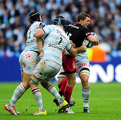 Alex Goode of Saracens takes on the Racing 92 defence - Mandatory byline: Patrick Khachfe/JMP - 07966 386802 - 14/05/2016 - RUGBY UNION - Grand Stade de Lyon - Lyon, France - Saracens v Racing 92 - European Rugby Champions Cup Final.