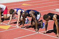 Male sprinters in starting blocks