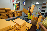 Office staff prepare 3510 student welcome packet in preparation for the first day of school at Chavez High School, August 20, 2014.