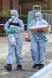 © Licensed to London News Pictures. 31/03/2019. London, UK. Forensic Officers at the crime scene on Fore Street in Edmonton, north London where a person was stabbed just after 9.30am this morning. The victim was taken to a hospital by Air Ambulance and his condition is unknown. Photo credit: Dinendra Haria/LNP