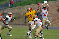 NCAA FCS: VMI football spring scrimmage - linebacker Weston Reber (#57) leads the VMI pass rush against quarterback Eric Kordenbrock, who nonetheless completed a long sideline pass to James Rogers during Saturday's spring scrimmage.