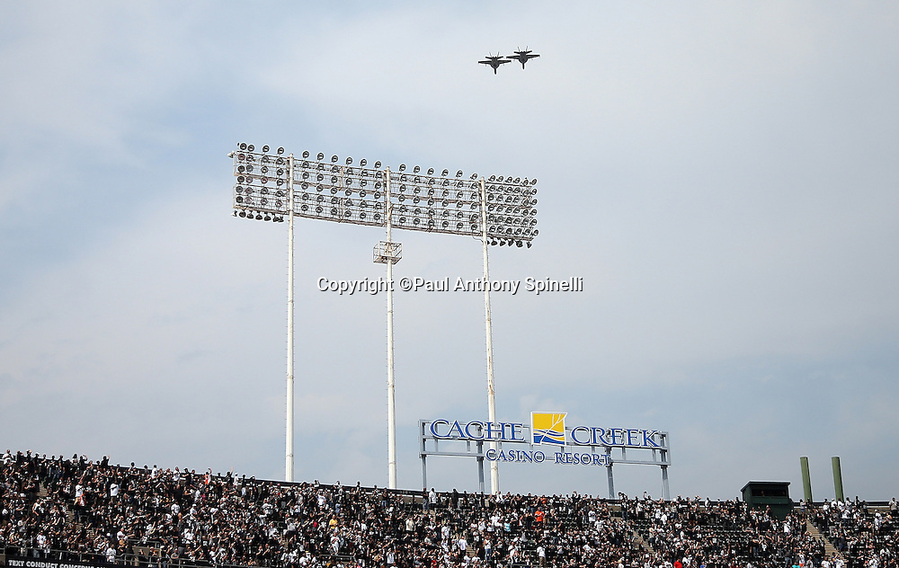 Jets fly over the stadium as part of pregame festivities before the Oakland Raiders 2015 NFL week 1 regular season football game against the Cincinnati Bengals on Sunday, Sept. 13, 2015 in Oakland, Calif. The Bengals won the game 33-13. (©Paul Anthony Spinelli)