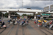 Eastern & Oriental Express. Entering Bangkok through the Northern suburbs. Motorbikes crossing rails after we pass by.