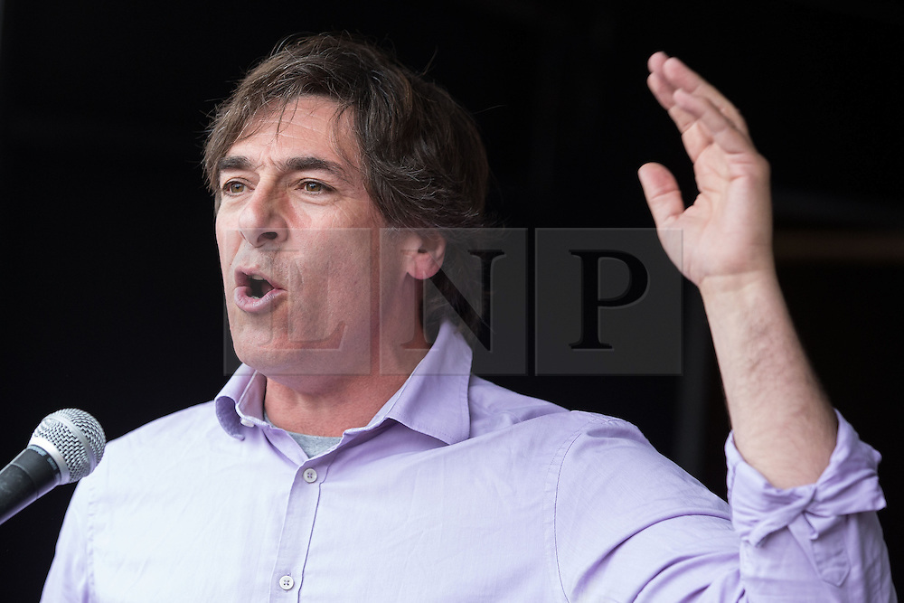 © Licensed to London News Pictures . 20/06/2015 . London , UK . MARK STEEL speaking in Parliament Square . Tens of thousands of people march from the Bank of England to Parliament , to protest economic austerity in Britain . Photo credit: Joel Goodman/LNP