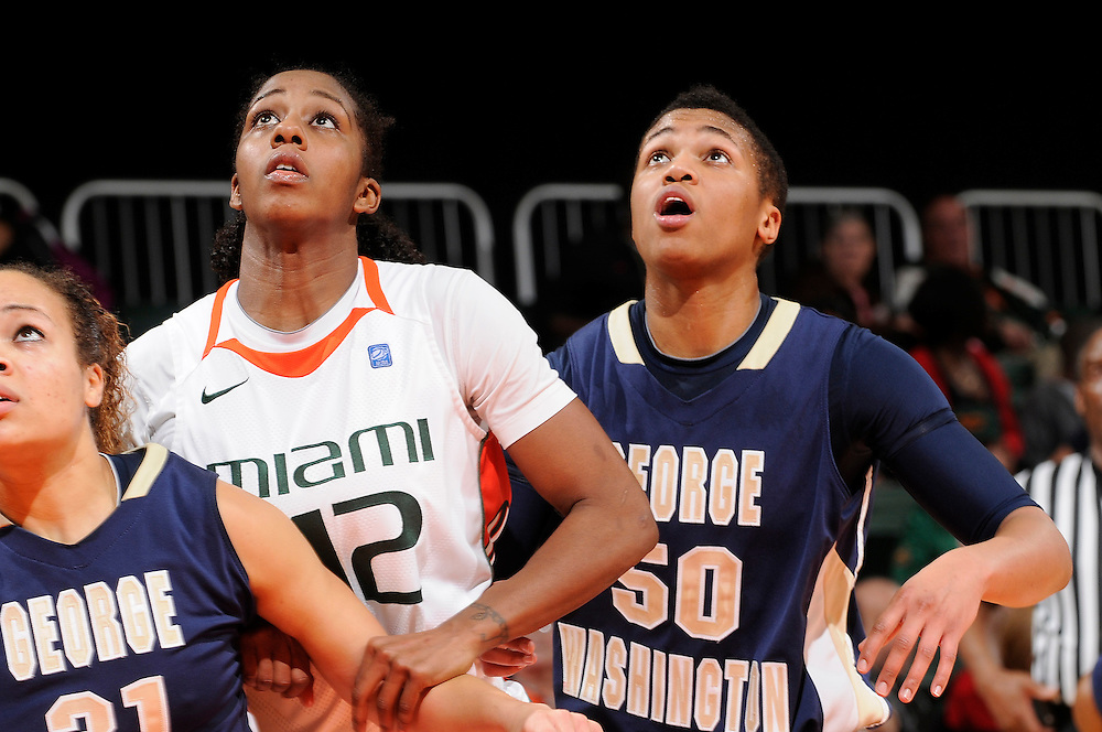 December 28, 2010: Kye Allums (50) of the George Washington Colonials battles Shenise Johnson (42) of the Miami Hurricanes for position during the NCAA basketball game between GWU and the Hurricanes. The 'Canes defeated the Colonials 83-62.