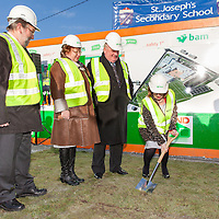 Minsiter of Education and Science, Ms. Jan O'Sullivan TD, turning the sod watched by the Head Teacher of St. Joseph's Secondary School, Tulla, and BAM Building Company Management