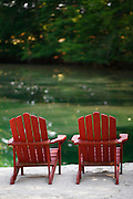 070911-Huntington, INDIANA-indiana-Two wooden red beach chairs near the swim beach on the pond Saturday, July 9, 2011 in Huntington, IN. .Photo By Matthew Jonas