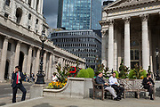 Traffic and Londoners outside the Bank of England in the City of London, the capital's financial district aka The Square Mile, on 29th August 2018, in London, England.