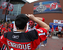 June 9, 2012; Newark, NJ, USA;  A New Jersey Devils gets his face painter before Game 5 of the 2012 Stanley Cup Finals at the Prudential Center.