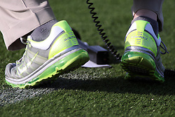 17 November 2012:  lime green sneakers during an NCAA Missouri Valley Football Conference football game between the North Dakota State Bison and the Illinois State Redbirds at Hancock Stadium in Normal IL This image available for EDITORIAL USE ONLY. A release may be required. Additional information by contacting alook at alanlook.com