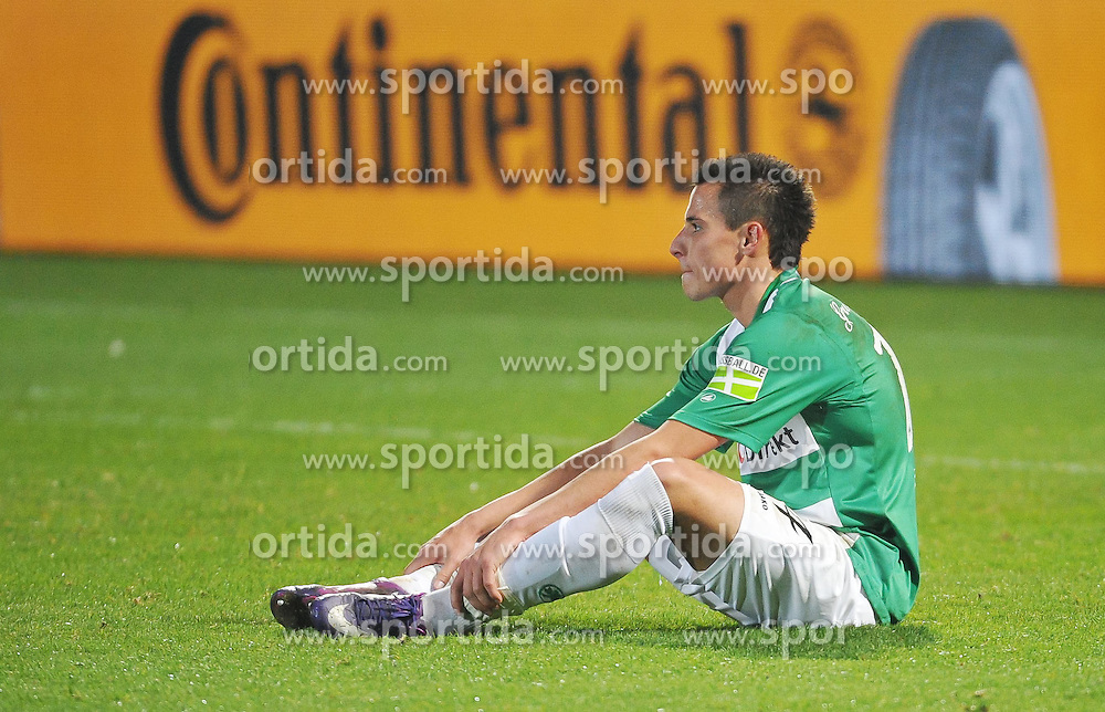 20.03.2012, Trolli Arena, Fuerth, GER, DFB Pokal, Halbfinale, SpVgg Greuther Fuerth vs Borussia Dormund, im Bild Frust bei den Spielern der SpVgg Greuther Fuerth nach dem Gegentor in der letzten Spielminute. Im Bild: Edgar Prib (SpVgg Greuther Fuerth). Freisteller // during the German DFB Pokal Match, Half-Final, between SpVgg Greuther Fuerth and Borussia Dormund at the Trolli Arena, Fuerth, Germany on 2012/03/20. EXPA Pictures © 2012, PhotoCredit: EXPA/ Eibner/ Matthias Merz..***** ATTENTION - OUT OF GER *****