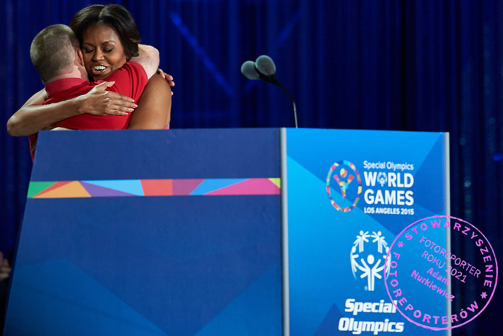 (L) Tim Harris and (R) Michelle Obama First Lady USA speaks during opening ceremony of the Special Olympics World Games Los Angeles 2015 at the Los Angeles Coliseum Stadium on July 25, 2015 in Los Angeles, USA.<br /> USA, Los Angeles, July 25, 2015<br /> <br /> Picture also available in RAW (NEF) or TIFF format on special request.<br /> <br /> For editorial use only. Any commercial or promotional use requires permission.<br /> <br /> Adam Nurkiewicz declares that he has no rights to the image of people at the photographs of his authorship.<br /> <br /> Mandatory credit:<br /> Photo by &copy; Adam Nurkiewicz / Mediasport