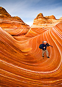 A photographer exploring The Wave section of Coyote Buttes North in Arizona.