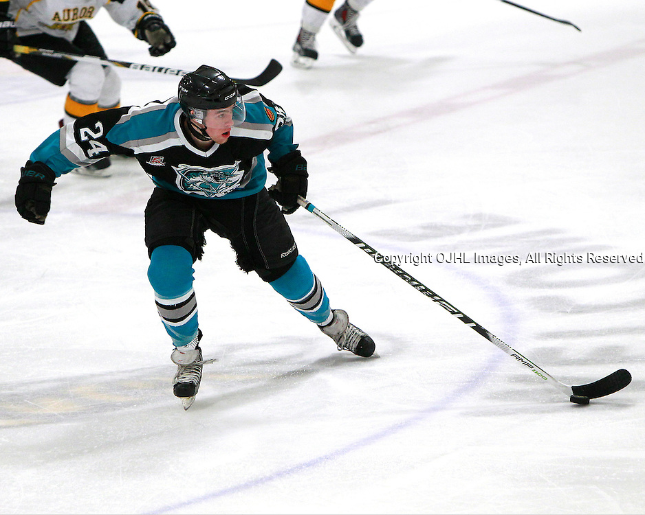 AURORA, ON - Jan 11 : Ontario Junior Hockey League Game Action between the Lindsay Muskies and the Aurora Tigers, Keegan Cairns #24 of the Lindsay Muskies skates with the puck during second period game action.<br /> (Photo by Brian Watts / OJHL Images)