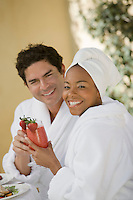 Portrait of couple in bathrobes, drinking at health spa