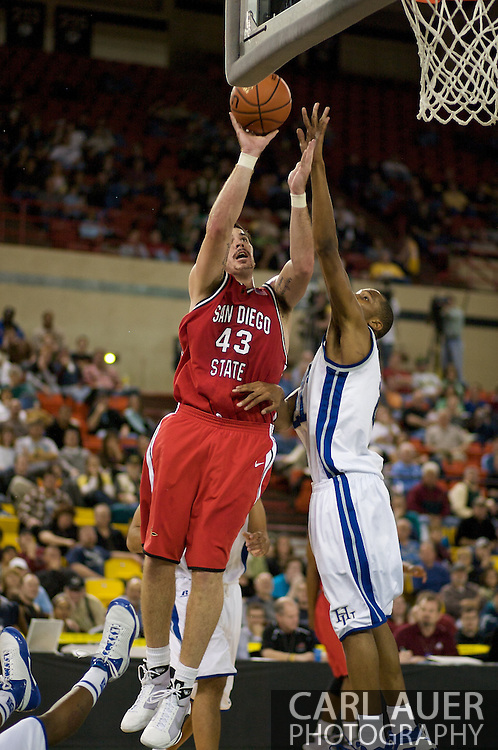 November 29, 2008: San Diego State forward Ryan Amoroso (43) slices to the hoop past the Hampton defense in the championship game of the 2008 Great Alaska Shootout at the Sullivan Arena.  San Diego State would keep Hampton scoreless for most of the first 7 minutes of the game and never look back on the Aztec's run to the win Saturday night.