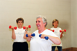 Elderly women taking part in keep fit class; Huddersfield; Yorkshire UK