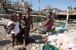 October 7, 2016 - Port Salute, Haiti - Women and children wash in the river after hurricane Matthew destroyed and flooded their houses, on October 7, 2016. Hurricane Matthew killed almost 900 people and displaced tens of thousands in Haiti before plowing northward on Saturday just off the southeast U.S. coast, where it caused major flooding and widespread power outages. (Credit Image: © Bahare Khodabande/NurPhoto via ZUMA Press)