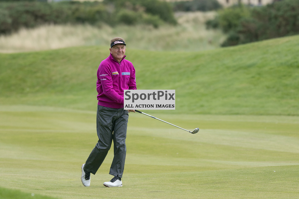 Paul BROADHURST (England) watches his second shot at the 18th (his 9th) hole.  Prostate Cancer UK Scottish Senior Open, 28th August 2015