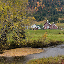 Indian Stream flows past a farm in Pittsburg, New Hampshire.  Fall.