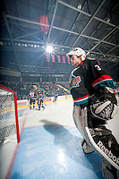 KELOWNA, CANADA - OCTOBER 18:  Jordon Cooke #30 and MacKenzie Johnston #22 of the Kelowna Rockets take part in a pre-game ritual on the ice as the Prince George Cougars visit the Kelowna Rockets on October 18, 2012 at Prospera Place in Kelowna, British Columbia, Canada (Photo by Marissa Baecker/Shoot the Breeze) *** Local Caption ***