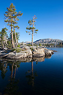 Trees are reflected in the clear blue water of Boundary Lake, Yosemite National Park
