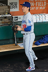 SAN FRANCISCO, CA - OCTOBER 02: Kenta Maeda #18 of the Los Angeles Dodgers stands in the dugout before the game against the San Francisco Giants at AT&T Park on October 2, 2016 in San Francisco, California.  (Photo by Jason O. Watson/Getty Images) *** Local Caption *** Kenta Maeda