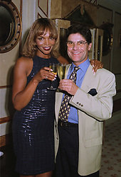 MRS VALERIE CAMPBELL mother of model Naomi Campbell, and MR REMI KRUG  at a party in London on 17th September 1997.MBI 8