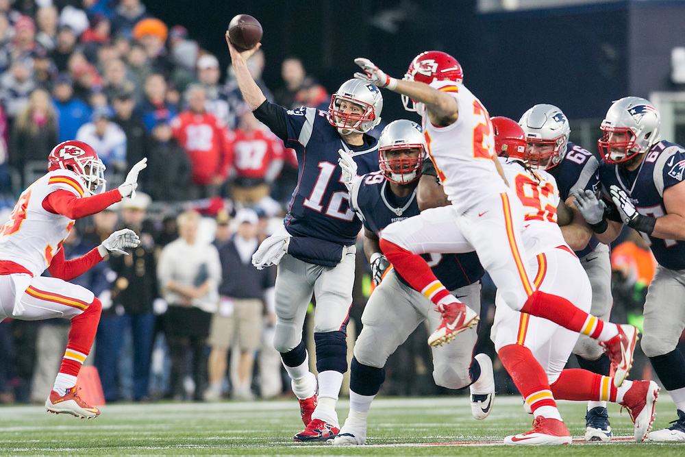 New England Patriots quarterback Tom Brady (12) passes through an opening in the Kansas City Chiefs defense in the first quarter of the AFC Divisional Playoff game at Gillette Stadium in Foxborough, Massachusetts on January 16, 2016.     Photo by Kelvin Ma/ UPI