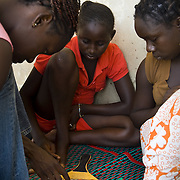 GOREÉ ISLAND (Senegal). 2007. Girls playing Parchis in Goreé