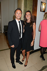 "Footballer DENNIS WISE and his wife CLAIRE at an ""Evening With Damon Hill'  a dinner and talk in aid of the Downs Syndrome Association held at Claridge's, Brook Street, London on 7th November 2013."