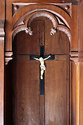 close up of a confessional with Jesus and cross