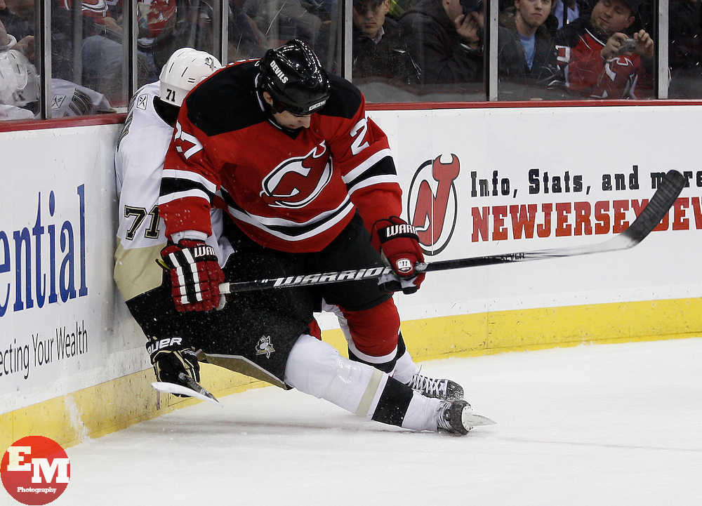Dec 30, 2009; Newark, NJ, USA; New Jersey Devils defenseman Mike Mottau (27) hits Pittsburgh Penguins center Evgeni Malkin (71) during the first period at the Prudential Center.