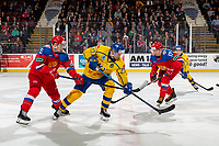 KELOWNA, BC - DECEMBER 18: Nikolay Kovalenko #15 stick checks David Gustafsson #27 of Team Sweden at centre ice at Prospera Place on December 18, 2018 in Kelowna, Canada. (Photo by Marissa Baecker/Getty Images)***Local Caption***Nikolay Kovalenko;David Gustafsson;Ivan Morozov;