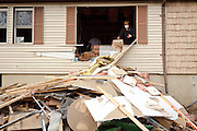 The Kats family gutted the inside of their flood-damaged home on Tarlton Avenue.