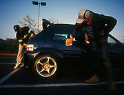 Two men polishing a customised car, UK, 2000'S