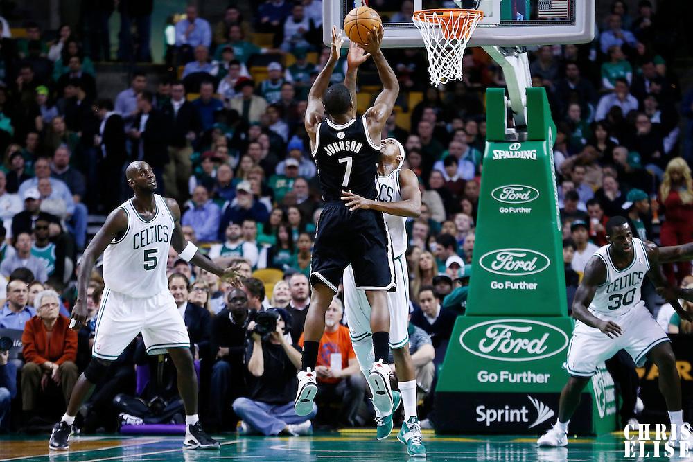 28 November 2012: Brooklyn Nets shooting guard Joe Johnson (7) takes a jumpshot over Boston Celtics small forward Paul Pierce (34) during the Brooklyn Nets 95-83 victory over the Boston Celtics at the TD Garden, Boston, Massachusetts, USA.